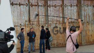 Douglas Brinkley, Nicolas Rodriguez-Brizuela, Kabir Sehgal, Arturo O'Farrill at the border wall