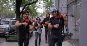 Ernesto Villalobos, Alberto Villalobos, Claudia Montes and Jorge Francisco Castillo play music while walking through New York