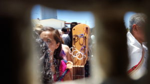 Peering through the wall from the US side during Fandango Fronterizo 2017